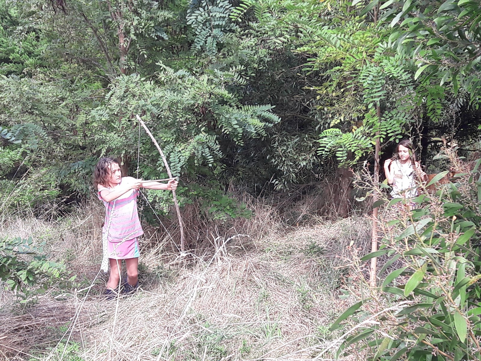 playing in the food forest Kahikatea Farm