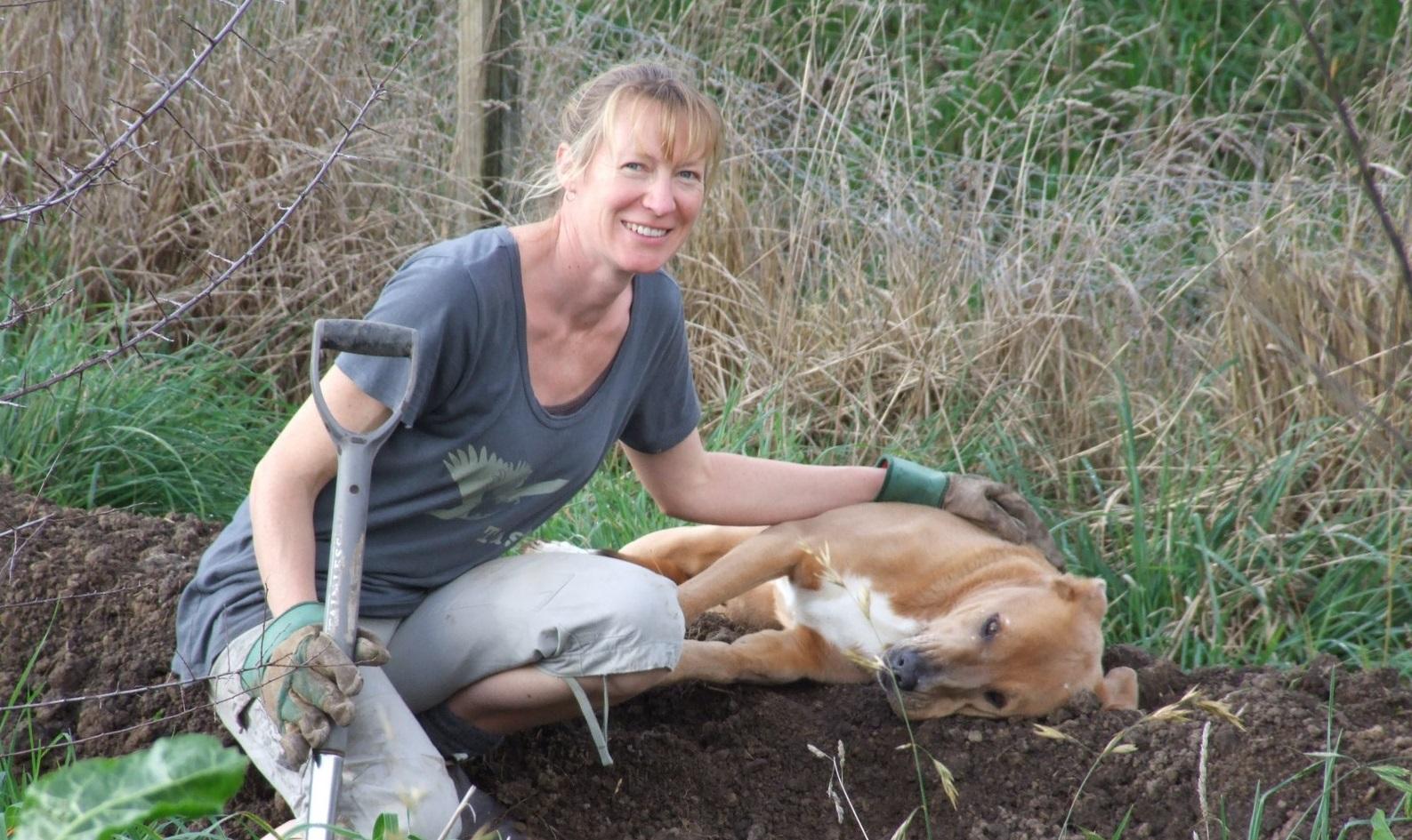 Jo Duff digging swales Kahikatea Farm
